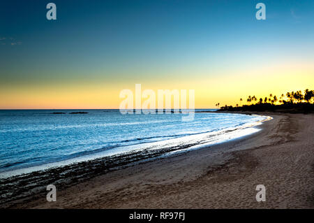 Sudown at the sands of Itapuã - Stock Photo