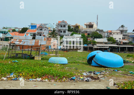 Mui Ne, Vietnam - December 27 2017. Despite being a major tourist attraction in the area, Mui Ne Fishing Village is littered with rubbish along the be - Stock Photo
