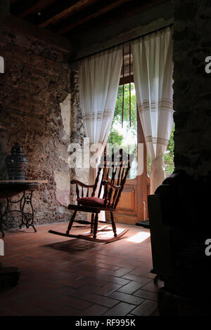 beautiful old rocking chair with light on the balcony - Stock Photo