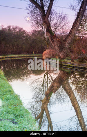 Frosty winter sunrise walk along the Staffordshire and Worcestershire canal - Stock Photo
