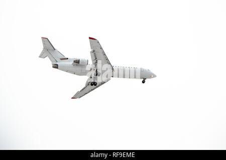 Aircraft with landing gear isolated on white background. - Stock Photo