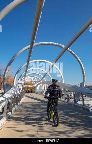 Washington, DC - A bicycle rider on the Anacostia Riverwalk Trail. - Stock Photo