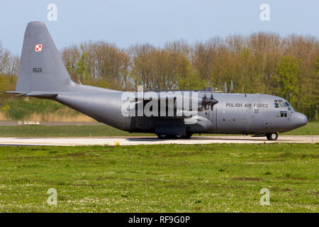LEEUWARDEN, THE NETHERLANDS - APR 21, 2016: Polish Air Force Lockheed C-130E Hercules transport airplane taxiing on Leeuwarden Air Base. - Stock Photo