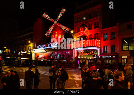 PARIS, FRANCE - NOVEMBER 9, 2018 - Moulin Rouge by night, is a famous cabaret built in 1889, locating in the Paris red-light district of Pigalle - Stock Photo