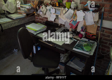 A photo of  workplace of a really busy science teacher. - Stock Photo