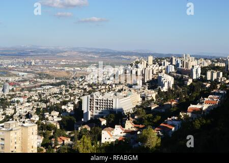 Dusk at Haifa, panorama view from louis promenade at bahai gardens - Stock Photo