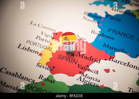 spain marked with a flag on the map - Stock Photo