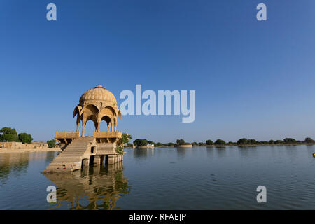 Gadi Sagar (Gadisar) Lake is one of the most important tourist attractions in Jaisalmer, Rajasthan, North India. Artistically carved temples and shrin - Stock Photo