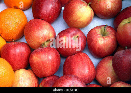 Fresh apples and oranges on display at farmers market - Stock Photo