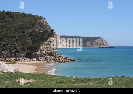 Boca do Rio on the western Algarve coast in southern Portugal is a beautiful bay with a small sandy beach enveloped by cliffs.. - Stock Photo