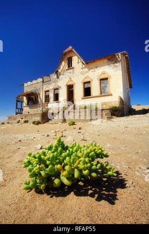 Exterior of German House in the deserted diamond mining town, Kolmanskop, Namibia - Stock Photo