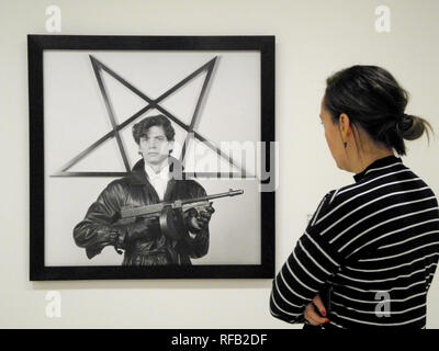New York, USA. 24th Jan, 2019. A visitor looks at a self-portrait of the photographer Robert Mapplethorpe in the exhibition 'Implicit Tensions: Mapplethorpe Now' at the Guggenheim Museum. With the exception of two weeks, the exhibition can be seen from July to January 2020. (to dpa 'Guggenheim Museum shows photos of Robert Mapplethorpe in New York' from 25.01.2019) Credit: Johannes Schmitt-Tegge/dpa/Alamy Live News - Stock Photo