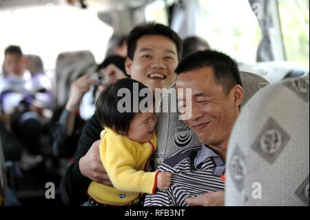 (190125) --BEIJING, Jan. 25, 2019 (Xinhua) -- File photo taken on Jan. 19, 2012 shows migrant worker Yang Liqiang (front, R) on a free bus ride home provided by Hunan Broadcasting System.     As the reunion with the family during the Lunar New Year is a long-standing tradition in China, people embark on journey home ahead of the Spring Festival, which falls on Feb. 5 this year.     The 40-day 2019 Spring Festival travel rush started on Jan. 21, with 3 billion trips expected to be made.     Here are some touching moments along the homeward bound journey. (Xinhua/Liang Xu) - Stock Photo