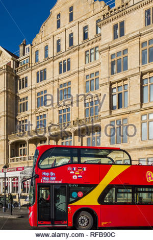 A Hop on Hop Off double decker tourist and sightseeing bus in Bath, Somerset, England, UK, run by the Bath Bus Company - Stock Photo
