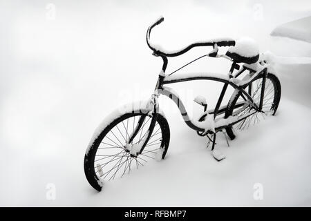 Kyiv, Ukraine - CIRCA January 2019: Bicycle covered in snow. Bicycle parked in snow. Bike buried in snow. Bike outdoors covered with a lot of snow, ba - Stock Photo