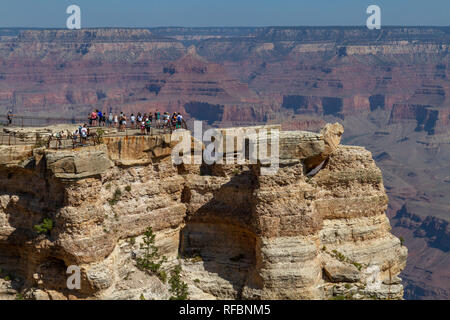 View of visitors on Mather Point with the Grand Canyon behind, South Rim, Grand Canyon National Park, Arizona, United States. - Stock Photo