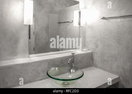 Interior of a modern bathroom. polished concrete style - Stock Photo