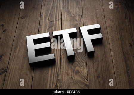 Metallic 3d ETF sign lying obliquely on wooden boards for an interesting header for Exchange Traded Funds with copy space - Stock Photo