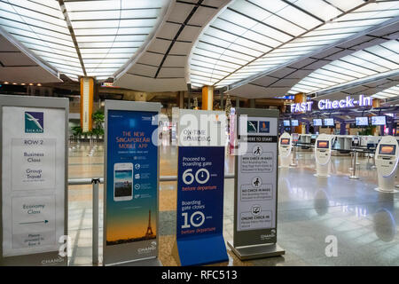 Singapore - January 2019: Singapore Airlines check-in counter in Singapore Changi Airport.  Singapore Airlines is one of the largest airlines in SEA - Stock Photo
