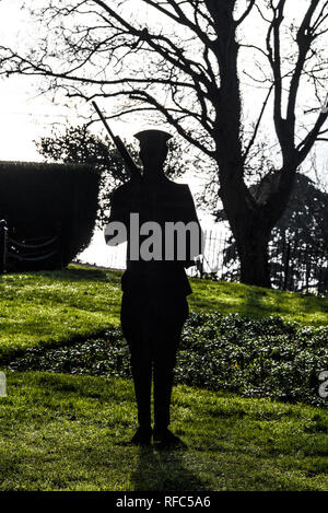 Great War Tommy silhouette soldier standing guard at Southend Cenotaph, Clifftown Parade, Southend on Sea, Essex, UK, overlooking Thames Estuary - Stock Photo