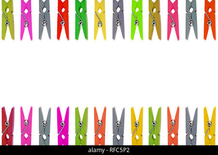 Colorful wooden clothespins on white background - Stock Photo