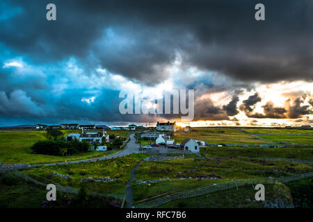 Sunset Over A Small Rural Village Beneath The Smoo Cave Near Durness In Scotland - Stock Photo