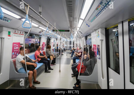Singapore - January 2019: Passengers in Singapore Mass Rapid Transit (MRT) train. The MRT has 102 stations,  the second-oldest metro system in SEA - Stock Photo