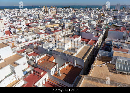 Aerial panoramic view of the old city rooftops and Cathedral de Santa Cruz in the morning from tower Tavira in Cadiz, Andalusia, Spain, Europe - Stock Photo