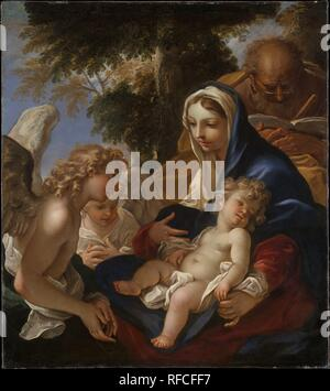 The Holy Family with Angels. Artist: Sebastiano Ricci (Italian, Belluno 1659-1734 Venice). Dimensions: 50 x 45 1/2 in. (127 x 115.6 cm). Date: ca. 1700.  An artist of remarkable facility and invention, Sebastiano Ricci achieved a reputation throughout Europe. This <i>Holy Family</i> reflects Ricci's admiration for the work of Ludovico Carracci. He would have had ample opportunity to study Ludovico's paintings when he moved from Venice to Bologna about 1678. The intimate treatment of the theme and the bespectacled figure of Saint Joseph reading a book are noteworthy. Museum: Metropolitan Museum - Stock Photo