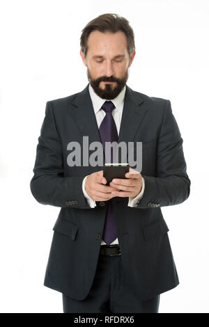 Sending important message. Businessman formal suit holds smartphone. Man bearded businessman concentrated on texting with colleague. Checking email or sending message. Smartphone gives opportunities. - Stock Photo