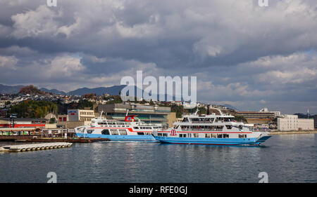 Hiroshima, Japan - Dec 28, 2015. Ferry carrying tourists to Miyajima Island. The Island of Gods, well known for its floating shrine and Otorii. - Stock Photo