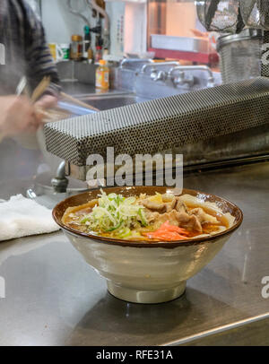 Miso soup with Ramen noodles for fast lunch at a cheap restaurant in Tokyo, Japan. - Stock Photo