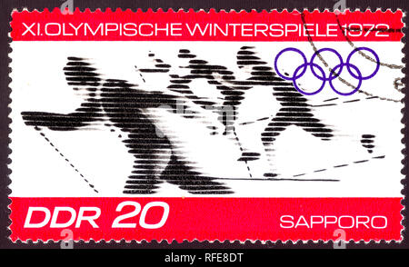 East Germany circa 1972:  Cancelled postage stamp printed in East Germany , that shows winter olympic skiing competition in Sapporo Japan 1972, circa  - Stock Photo
