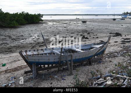 Ibo Island Lodge Hotel, Ibo Island, Mozambique, East Africa. A local fishermans boat being repaired. - Stock Photo