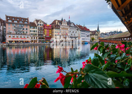 View from the Chapel Bridge of the historic city of Lucerne in autumn light