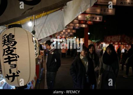 Japanese people and lantern during Hatsumode or New Year at Ikuta Shrine in Kobe, Japan - Stock Photo