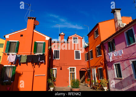 Burano island, famous for its colorful fishermen's houses, in Venice, Italy - Stock Photo