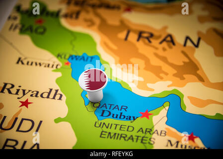 Qatar marked with a flag on the map - Stock Photo