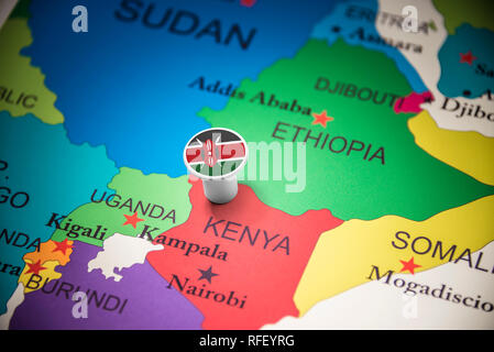 Kenya marked with a flag on the map - Stock Photo