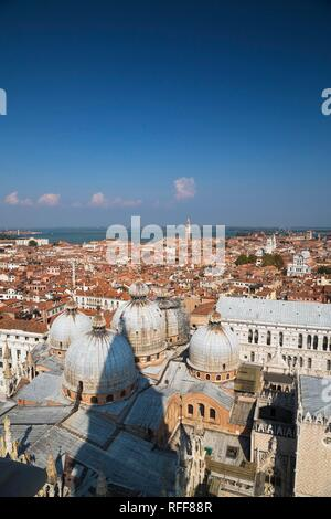 St Mark's Basilica with Romanesque domes and ornate Gothic and Byzantine architectural details plus the Doge's Palace built in - Stock Photo
