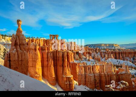 Rock formation Thors Hammer, morning light, bizarre snowy rock landscape with Hoodoos in winter, Navajo Loop Trail - Stock Photo