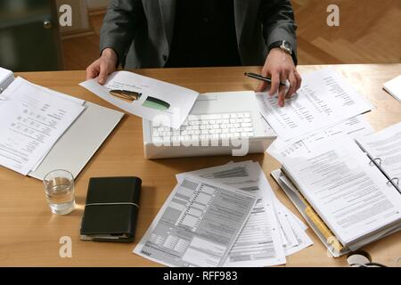 DEU, Germany : Man works in an office, at a desk - Stock Photo