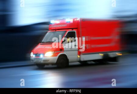 DEU Germany: Essen fire brigade. Ambulance on the way to an emergency with flashing blue lights.| - Stock Photo