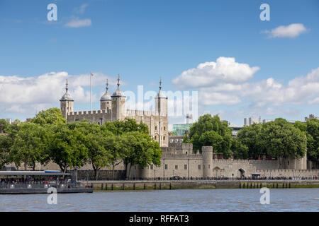 The famous White Tower and the Tower of London, as seen from Southbank across the River Thames.  Popular historical tourist attraction on a summer day - Stock Photo