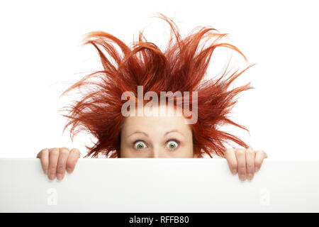 Redhead woman with messy hair with copy space - Stock Photo