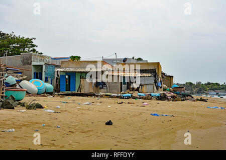Mui Ne, Vietnam - December 27 2017. Houses at Mui Ne Fishing Village. Despite being a major tourist attraction in the area, it is littered with rubbis - Stock Photo