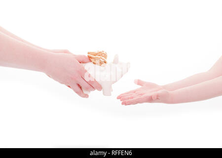 A parent hands the piggy bank to his child - Stock Photo