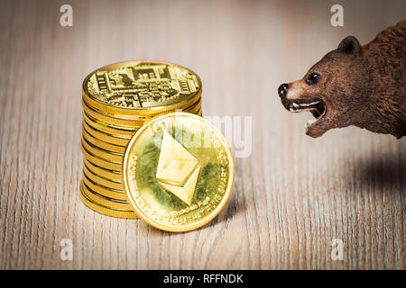 Cryptocurrency ethereum bear figure on a wooden table. Bearish market trend concept - Stock Photo