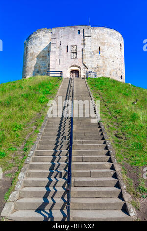 York, England, United Kingdom: Clifford's Tower, a fortified complex comprising of castles, prisons, law courts - Stock Photo