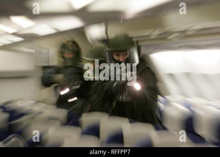 DEU, Germany, Duesseldorf : Police officers of a SWAT Team on a training misson in an airplane, in case of a highjacking. | - Stock Photo